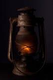 Old kerosene lantern. Old kerosene lamp on black Royalty Free Stock Images
