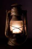 Old kerosene lantern. Burning with bright flame Royalty Free Stock Images