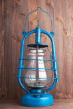 Old kerosene lantern. On the dark wooden background Stock Image