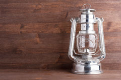 Old kerosene lantern. On the dark wooden background Stock Photography