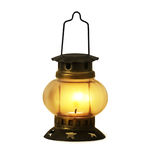 Old kerosene lantern burning Royalty Free Stock Photography