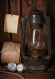 Old kerosene stove, clock and a roll of twine Stock Photo