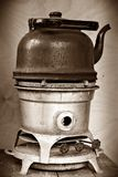 Old kerosene stove with a sooty kettle.  Royalty Free Stock Photo