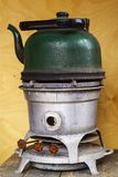 Old kerosene stove with a sooty kettle.  Royalty Free Stock Images