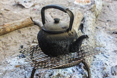 Old kettle boiling water for coffee or Tea in countryside Stock Photography