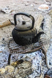 Old kettle boiling water for coffee or Tea in countryside in Thai Royalty Free Stock Image