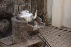 Old kettle for boiling water on stove Stock Photography