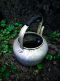 An old kettle with the brick wall stock image