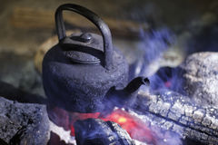 Old kettle at campfire. Old kettle boilling water at campfire Royalty Free Stock Photos