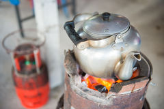 The old kettle on a charcoal stove Stock Photography