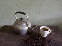 Old kettle and coffee Royalty Free Stock Images