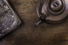 Old kettle on a grunge wooden surface Royalty Free Stock Photo