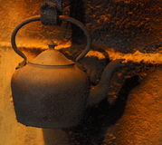 Old Kettle Hanging Over Hearth Royalty Free Stock Image