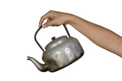 Old kettle in man hand. Isolated on white background Stock Photos