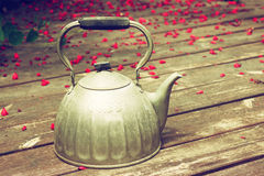 Old kettle over wooden planks. filtered image. Stock Images