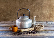 Old kettle,paper roll,rope reel and coffee beans Stock Photo
