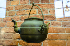 The old kettle. Old retro kettle. Green tea-water is a beautiful decorative look. This old kettle Stock Image