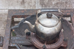 Old kettle on rusty gas stove Stock Image