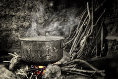 Old kettle sitting on hot fire Royalty Free Stock Photo