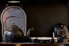 Old kettle on the stove. Detail of the old rusty kettle Royalty Free Stock Photography