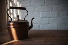 Old kettle on the table . stock photos