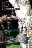 Old kettle under faucet Royalty Free Stock Photography