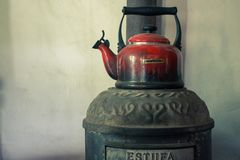 Old kettle with water stock photography