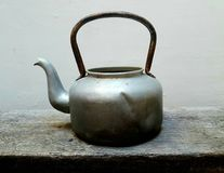 The old kettle. On old wood Royalty Free Stock Images