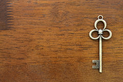 Old key. On a wooden background, texture Stock Photos