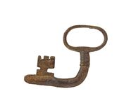 Old key. Bended vintage old key isolated on white background Stock Photos