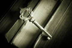 Old key on antique books. Royalty Free Stock Photo