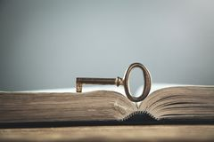 Old key on bible. Concept of wisdom and knowledge royalty free stock photo