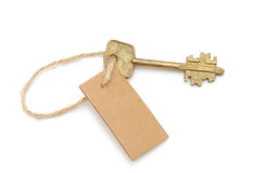Old key and blank label Royalty Free Stock Photo