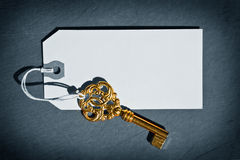 Old Key. An old key with a blank tag attachet to it Royalty Free Stock Image