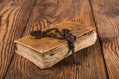 Old key with book Stock Photography