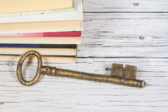 Old key and books Royalty Free Stock Images