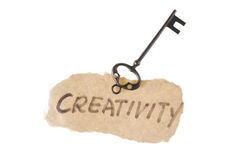Old key and creativity word Royalty Free Stock Photo