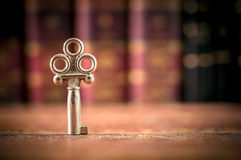 Old Key on a Desk - Copy-space Stock Photography