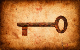 Old key on Grunge old paper texture Royalty Free Stock Photo