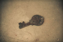 Old key. On the old Grunge Textured Background Stock Images