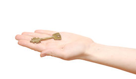 Old key in hand woman Stock Photo