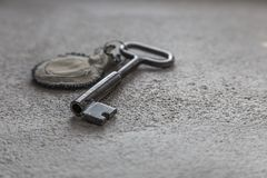 Old key with handmade key chain. Closeup of an old key with handmade key chain Stock Photos