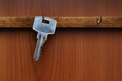 Key hanging from hook on the wall. The key hanging on the hanger Royalty Free Stock Photo