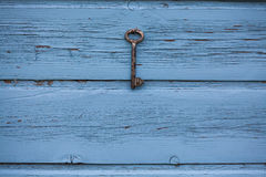 Old key hanging on the wall Royalty Free Stock Photography
