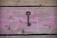 Old key hanging on the wall Royalty Free Stock Photos