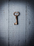 Old key hanging on wall Royalty Free Stock Images