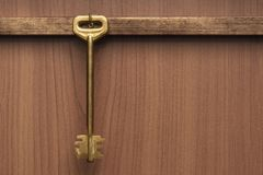 Old Brass Key hanging on a Wall Stock Photo