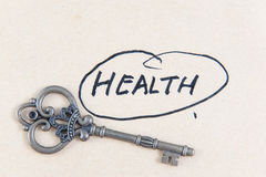 Old key and health word Royalty Free Stock Photo