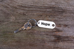 Old key With Hope Text. Wooden texture background Stock Photography