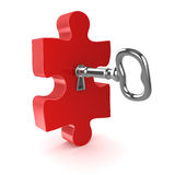 Old key with jigsaw puzzle piece Royalty Free Stock Photo